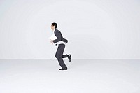 Businessman running with document, blurred motion