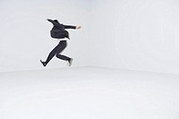 Businessman leaping, blurred motion