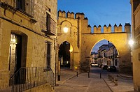 Jaen town gate at dusk in Populo square, Baeza. Jaen province, Andalucia, Spain