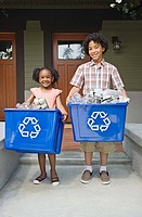 Siblings with recycling bins