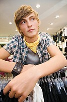 Teen boy in clothing store