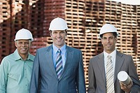 Businessmen and foreman on dock