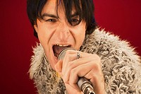 Rock star singing into microphone