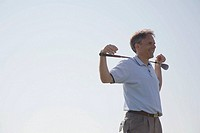 Smiling man with golf club