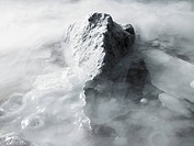 Iceberg surrounded by mist
