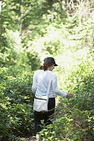 Woman walking through woods