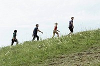 Friends climbing a hill