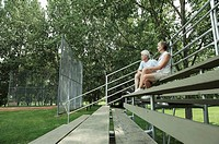 Couple sitting in bleachers