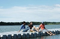 Friends relaxing on a dock