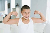 Boy flexing muscles