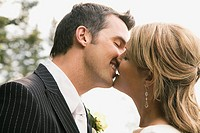 Bride and bridegroom kissing