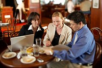Businesspeople working in restaurant