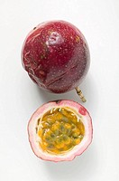 Purple passion fruits, whole and half