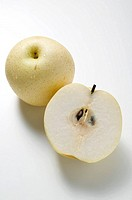 Whole Nashi pear and half a Nashi pear overhead view