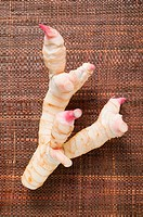 Fresh galangal on brown fabric background