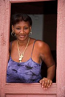 Lady standing in a doorway, Trinidad, Sancti Spiritus Province, Cuba