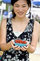 Woman holding raspberries