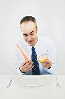 Man choosing between donut and carrot