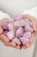 Hands holding healing stones