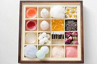 A selection of beauty products and flowers in type case (thumbnail)