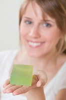 Woman holding green soap