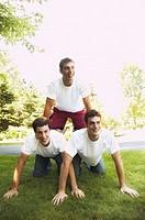 Brothers making a human pyramid