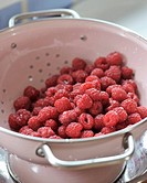 Fresh raspberries in a colander