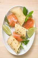 Pancake with soft cheese, smoked salmon, herbs, lime