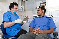 Dentist in consultation with a patient.