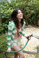 Woman with Hose in Garden