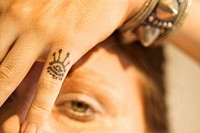 Woman with tattoo on her hand