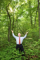 Businessman in woods
