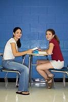 Teenage girls studying