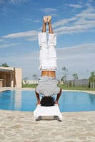 Man standing on head