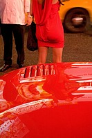 United States, New York, Manhattan, near Times square, woman with red dress and red car