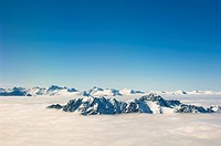 Peaks of the Southern Alps above Clouds