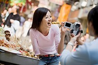 Man Videotaping Girlfriend Trying Street Food
