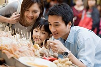 Family Looking at Street Food