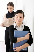 Young women with newspaper and file