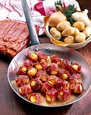 Skewers of Charlotte potatoes and bacon
