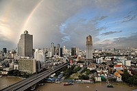 Double rainbow over Bangkok, Thailand. End of the rainbow is at the domed State Tower. Vantage point is from Thonburi, across the Chao Phraya river. T...