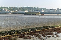 Vestiges of the Mulberry harbour built during the second world war _ In the background Arromanches city