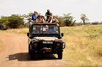 Tourists on a safari, Serengeti National Park, Tanzania, Africa