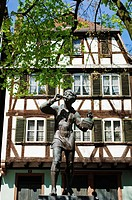 'Meiselocker' tit bird catcher statue by Ernst Weber and half-timbered house, Place Saint-Etienne, Strasbourg, Alsace, France
