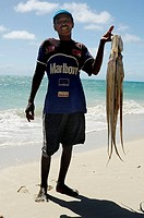 Local fisherman with two big octopus, Madagascar