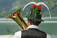 Hornplayer of the Niklasreuth brassband wearing a traditional hat at the Alt-Schliersee churchday, Lake Schliersee, Upper Bavaria, Germany, Europe