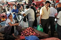 Woman selling onions at the local market, Santa Cruz, Bolivia, South America