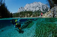 Diver in the Gruener See Lake being watched by a woman on the shore, Tragoess, Styria, Austria, Europe