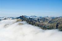 Fog drifting above Schladminger Tauern Range, St. Nikolei, Styria, Austria, Europe