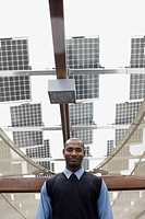 African businessman standing near solar panels